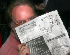 Marvman taking a moment for fine reading -- which BTW:  a Smokin' Dave's menu IS!!!!!!  :)
